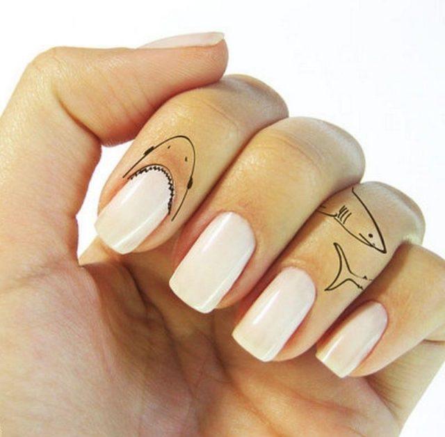 Shark finger tattoo