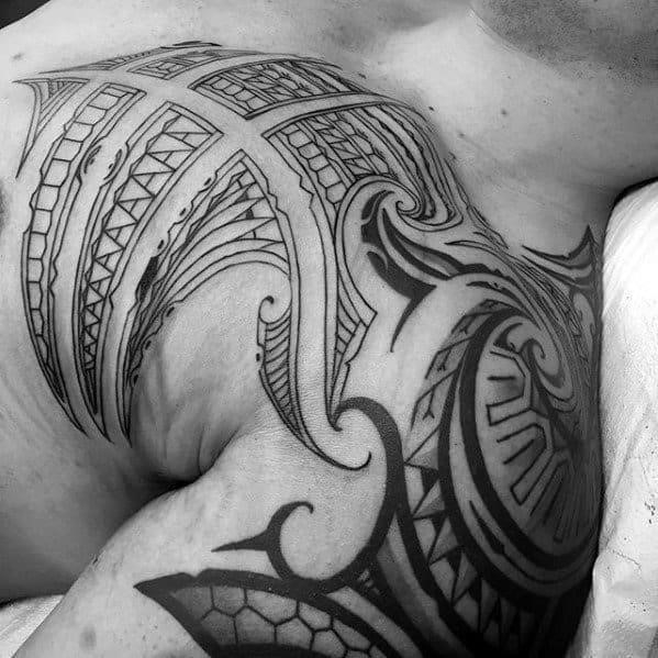 Shoulder cap and upper chest sick tribal tattoo designs for men