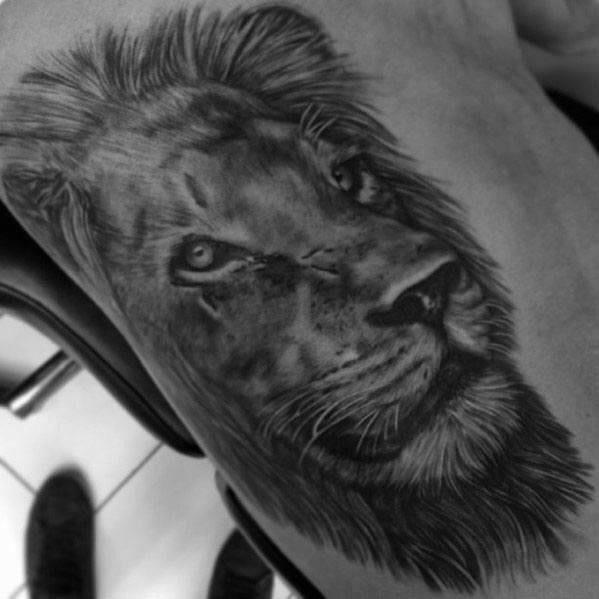 Side of ribcage male realistic lion tattoo