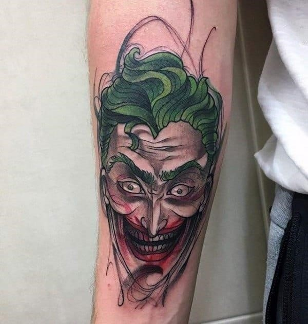 Sketched color male joker inner forearm tattoos