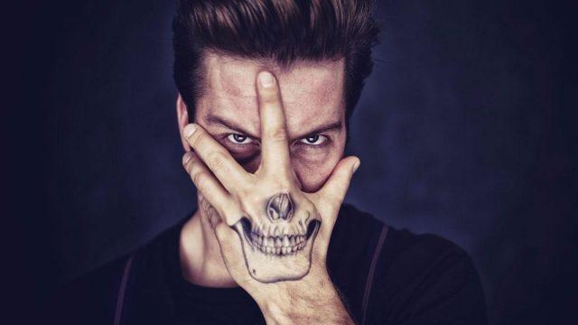 Skull hand tattoo 35407