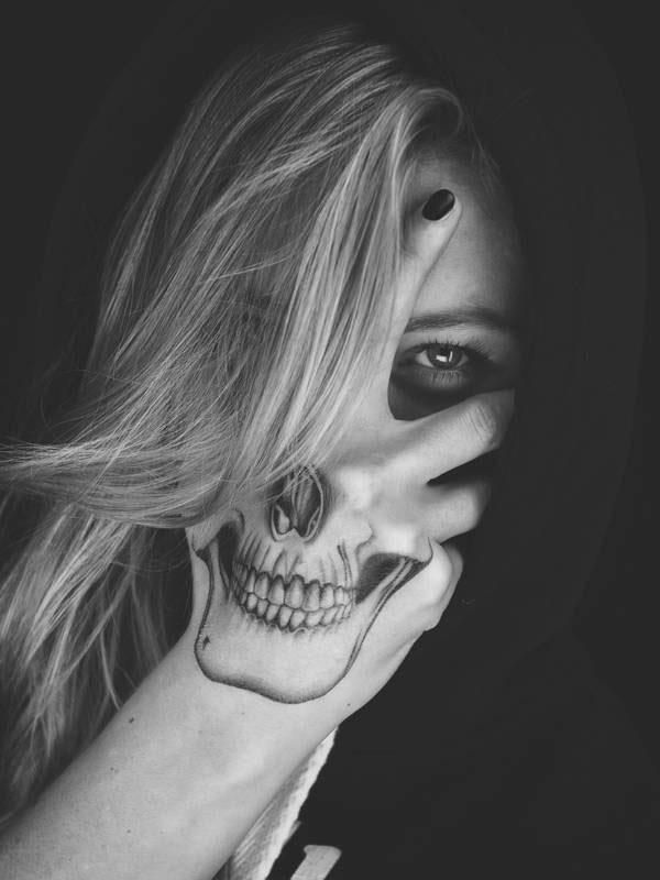 Skull hand tattoo 35408