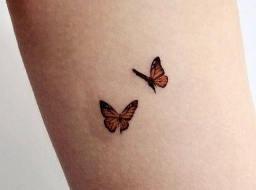 Small butterfly tattoo e1583860341975