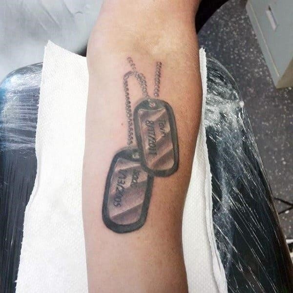 Small dog tag tattoos designs for guys