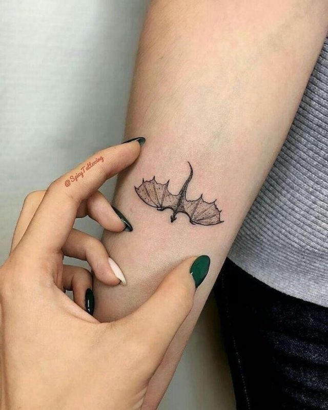Small dragon tattoo on the forearm dragon tattoo meaning woman with green nail polish