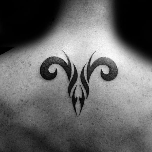 Small simple aries back male tattoos