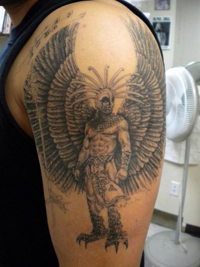 Standing aztec warrior tattoo design