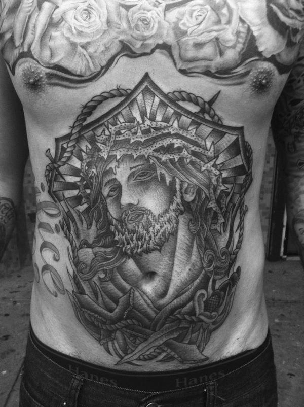 Stomach tattoo jesus