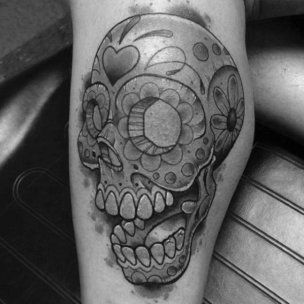 Sugar skulls tattoos on man