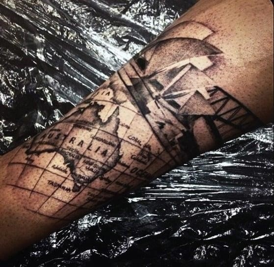 Tattoo of australia map on mans forearm