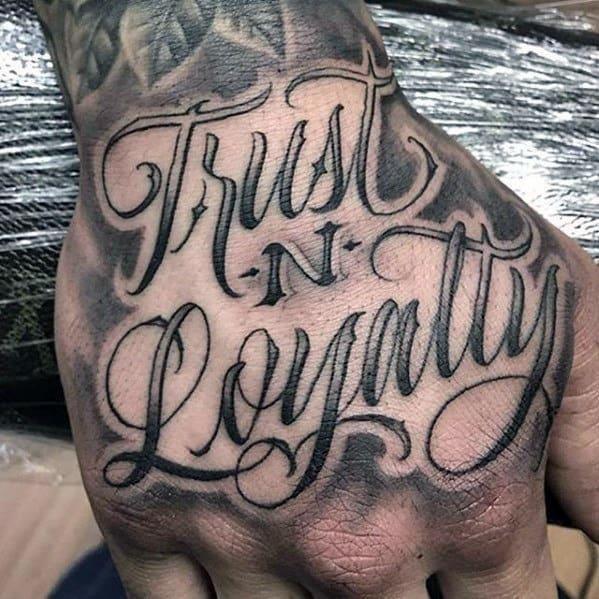 Trust and loyalty script badass mens hand tattoos