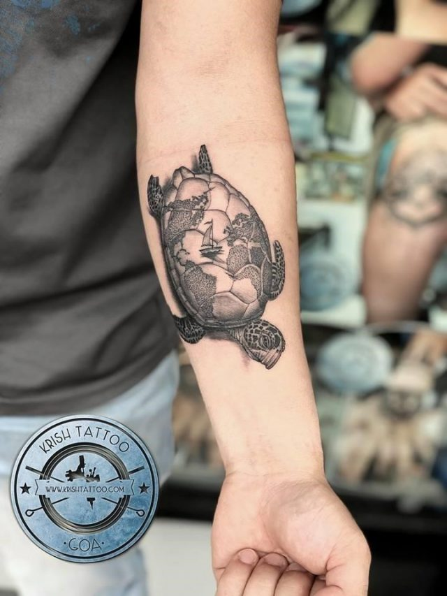 Turtle tattoo with world map