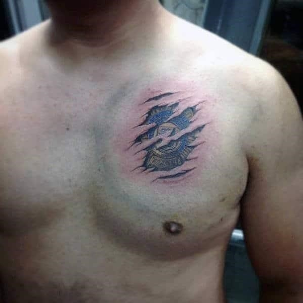 Upper chest mens torn skin police tattoo