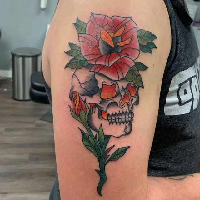 Watercolor painting skull rose tattoo