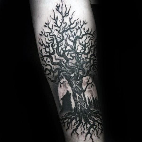 Wolf howling at the moon with family tree mens inner forearm tattoo