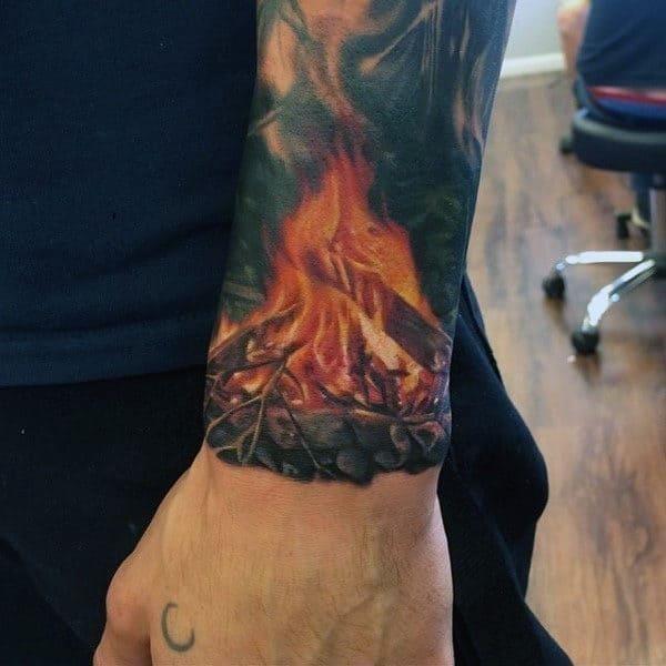 Wrist flame camp fire tattoo on man