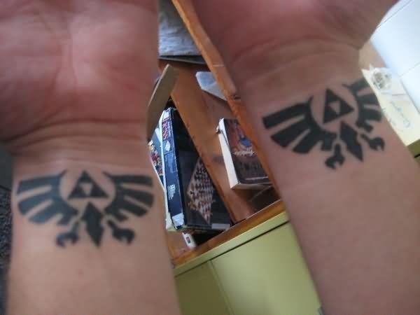 Zelda crest wrist tattoos
