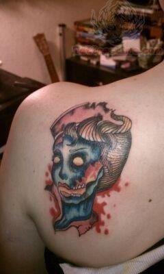 Zombie nurse tattoo on back shoulder